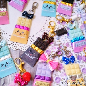 Chocolate bar with packaging / different colors / charms