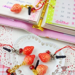 Strawberry / different colors / charms & dust plugs