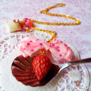 Strawberry with a ribbon bow / gold colored / necklace