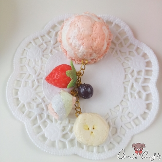 Scoop of ice cream with fruits / gold and silver colored / pin