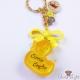 Anhänger, Gelbes Entchen aus Resin mit Glitzer, Perlen und einer gelben Schleife, Gold
