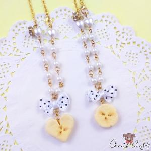 Banane mit Perlen und Schleife / Verschiedene Varianten / Goldfarbend / Halskette