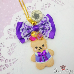 Bear shaped cookie with ribbon bow / purple / gold colored / necklace