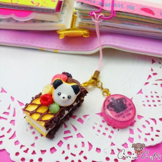 Marshmallow waffle with chocolate and a panda / gold colored / charm