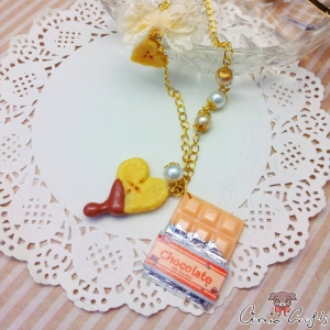 Wrapped chocolate bar / banana and caramel / gold colored / necklace