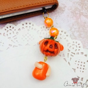 Pumpkin with two faces / gold colored / dust plug