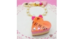 Heart shaped cake / gold-colored / bag charm