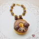 Dog shaped donut / gold colored / bag charm