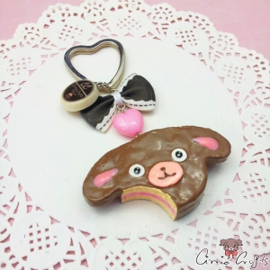 Bitten dog shaped cake / silver colored / keychain