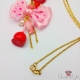 Candy apple with a pink ribbon bow / gold colored / necklace