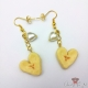 Heart shaped bananas / gold colored / earring hooks