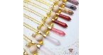 Faceted gemstone with a wood bead / gold colored / bullet / different colors / necklaces