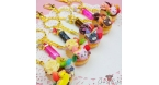 Decorated donut with an animal shaped cookie / different variations / gold colored / charm