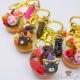 Dekorierte Donuts mit Keksen in Tierform / Verschiedene Varianten / Goldfarbend / Anhänger