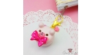 Bear shaped macaron with a ribbon bow / gold colored / charm