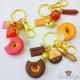 Donut mit Icing / Goldfarbend / Verschiedene Varianten / Schlüsselanhänger